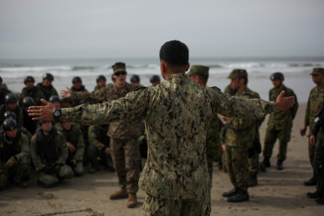 Marines with 1st Reconnaissance Battalion, 1st Marine Division, teach Basic Maneuver Techniques for the Combat Rubber Raiding Craft to members of the Japan Ground Self-Defense Force aboard Camp Pendleton on Jan. 28, 2015, during Exercise Iron Fist 2015 to help develop the Self-Defense Force's understanding of amphibious operations. Exercise Iron Fist 15 is an annual bilateral training exercise between U.S. and Japanese military forces that builds their combined ability to conduct amphibious and land-based contingency operations. IF15, currently in its tenth iteration, is scheduled from Jan. 26 to Feb. 27, 2015, in southern California. (U.S. Marine Corps photo by Lance Cpl. Angel Serna/Released)