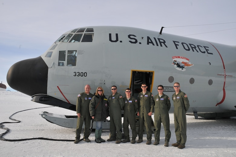 Secretary of the Air Force Deborah Lee James (second to the left) poses for a photo with aircrew from the 139th Expeditionary Airlift Squadron in front of a LC-130 Hercules during her visit with participants of Operation DEEP FREEZE, at McMurdo Station, Antarctica, Jan. 25, 2015. DEEP FREEZE involves active duty and Reserve C-17 Globemaster III support from Joint Base Lewis-McChord, Wa., LC-130 Hercules support from the New York Air National Guard, sealift support from the U.S. Coast Guard and Military Sealift Command, engineering and aviation services from U.S. Navy Space and Naval Warfare Systems Command, and cargo handling from the U.S. Navy. Operation DEEP FREEZE 2015 is part of the U.S. Antarctic program, which is managed by the National Science Foundation. (U.S. Air Force courtesy photo)