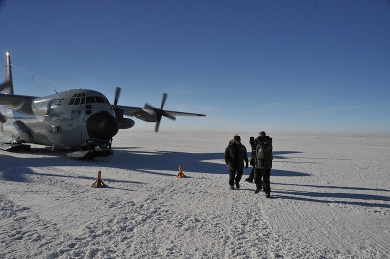 Secretary of the Air Force Deborah Lee James (left) walks from a LC-130 Hercules with aircrew from the 139th Expeditionary Airlift Squadron during her visit with participants of Operation Deep Freeze, at McMurdo Station, Antarctica, Jan. 25, 2015. DEEP FREEZE involves active duty and Reserve C-17 Globemaster III support from Joint Base Lewis-McChord, Wa., LC-130 Hercules support from the New York Air National Guard, sealift support from the U.S. Coast Guard and Military Sealift Command, engineering and aviation services from U.S. Navy Space and Naval Warfare Systems Command, and cargo handling from the U.S. Navy. Operation DEEP FREEZE 2015 is part of the U.S. Antarctic program, which is managed by the National Science Foundation. (U.S. Air Force courtesy photo)