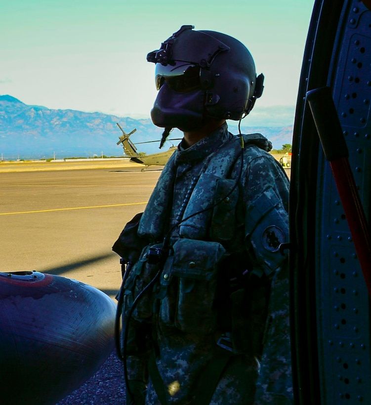 A U.S. Army crew chief assigned to the 1st Battalion, 228th Aviation Regiment starts pre-flight checks on a UH-60 Blackhawk helicopter for deck landing qualifications at Soto Cano Air Base, Honduras, Feb. 1, 2015.  The 1-228th Avn. Reg. aircrew participated in deck landing qualifications on board the USS Kauffman to qualify pilots and crew chiefs on shipboard operations.   Kauffman is on its final scheduled deployment to the U.S. Southern Command area of responsibility supporting multinational, counter-narcotics operation known as Operation Martillo. (U.S. Air Force photo/Tech. Sgt. Heather Redman)
