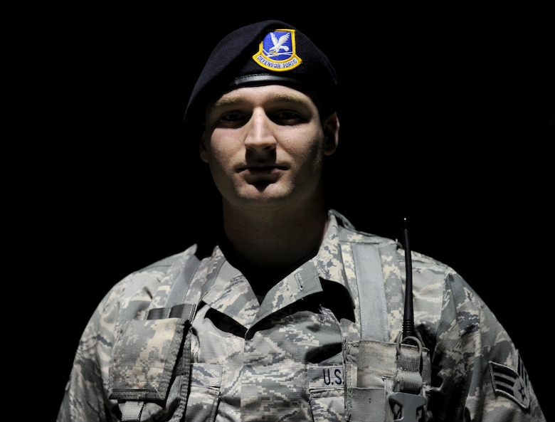 Senior Airman Richard Lubben, 9th Security Forces Squadron, poses at a gate entrance at Beale Air Force Base, Calif., Jan. 15, 2015. (U.S. Air Force photo by Staff Sgt. Robert M. Trujillo/Released)