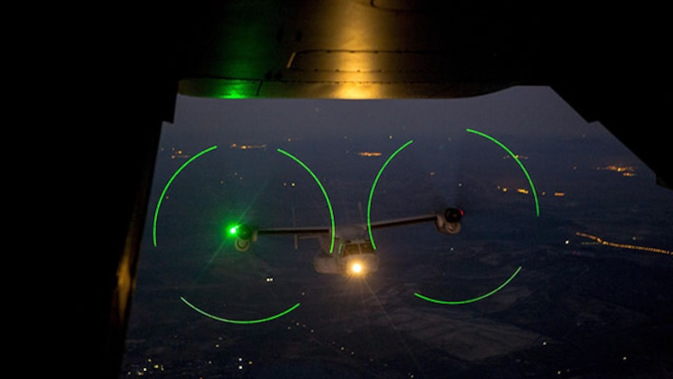 An MV-22 Osprey from Special-Purpose Marine Air-Ground Task Force Crisis Response – Africa flies toward an aerial refueling point near the coast of Spain Jan. 28, 2015. The ability to complete on-the-move refueling greatly extends the operational capabilities of SPMAGTF-CR-AF, which is tasked with providing a crisis response force for Africa. (U.S. Marine Corps photo by Lance Cpl. Christopher Mendoza/Released)