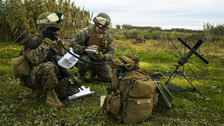 Lance Cpl. Jason Barreras, a field radio operator with Special-Purpose Marine Air-Ground Task Force Crisis Response – Africa helps coordinate the extraction of a simulated casualty during an alert-force drill at Rota Air Base, Spain, Jan. 29, 2015. Barreras helped maintain constant communication with unit commanders and essential personnel as they completed the unscripted mission, which was designed to test the unit's ability to rapidly adapt and respond to a crisis situation. (U.S. Marine Corps photo by Sgt. Paul Peterson/Released)
