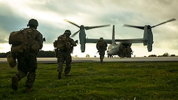 Marines with Special-Purpose Marine Air-Ground Task Force Crisis Response – Africa run aboard an MV-22 Osprey during an alert-force drill at Rota Air Base, Spain, Jan. 29, 2015. A platoon of Marines successfully carried out a simulated casualty evacuation mission launched from their staging area at Morón Air Base, Spain, where SPMAGTF-CR-AF is postured to respond to regional crises. (U.S. Marine Corps photo by Sgt. Paul Peterson/Released)