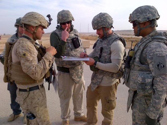SOUTWEST ASIA - Members of the 62nd Forward Engineer Support Team discuss infrastructure needs with the Marines in Iraq.