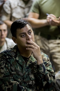 Mexican Marine 1st Lt. Manuel Ortiz with Headquarters and Service Company, 2nd Battalion 6th Marines, listens to a brief on the upcoming events during exercise Bold Alligator 14, on the USS Kearsarge (LHD3), Oct. 30, 2014. Exercise Bold Alligator 14 is a multi-national, synthetic naval exercise designed to train the full range of amphibious capabilities in order to provide unique and contemporary solutions to global challenges.