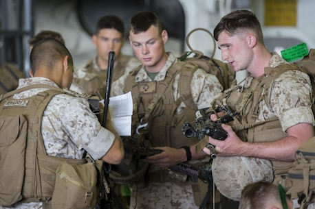 U.S. Marines with Echo Company, 2nd Marines 6th Regiment, perform a weapons check on the USS Kearsarge (LHD-3) during exercise Bold Alligator 14, off the eastern coast of the United States, Nov. 1, 2014. Exercise Bold Alligator 14 is a multi-national, synthetic naval amphibious exercise designed to train across the full range of amphibious capabilities in order to provide unique and contemporary solutions to global challenges.
