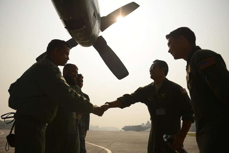 C-130H Hercules crew members from the 36th Airlift Squadron at Yokota Air Base, Japan, meet with a Bangladesh air force C-130B crew from the 101st Special Flying Unit Jan. 27, 2015, during exercise Cope South 15 (CS15) at BAF Base Bangabandhu. The exercise helped cultivate common bonds, foster goodwill, and improve readiness and compatibility between members of the Bangladesh and U.S. air forces. CS15 is a Pacific Air Forces-sponsored, bilateral tactical airlift exercise conducted in Bangladesh, with a focus on cooperative flight operations, day and night low-level navigation, tactical airdrop, and air-land missions as well as subject matter expert exchanges in the fields of operations, maintenance and rigging disciplines. (U.S. Air Force photo/1st Lt. Jake Bailey)
