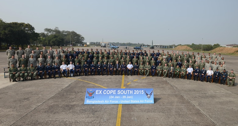 U.S. and Bangladesh air force personnel gather for a group photo at the close of exercise Cope South 15 (CS15) Jan. 29, 2015, at BAF Base Bangabandhu, Bangladesh. The exercise helped cultivate common bonds, foster goodwill, and improve readiness and compatibility between members of the Bangladesh and U.S. air forces. CS15 is a Pacific Air Forces-sponsored, bilateral tactical airlift exercise conducted in Bangladesh, with a focus on cooperative flight operations, day and night low-level navigation, tactical airdrop, and air-land missions as well as subject matter expert exchanges in the fields of operations, maintenance and rigging disciplines. (U.S. Air Force photo/1st Lt. Jake Bailey)