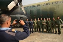 U.S. and Bangladesh air force (BAF) personnel take a group photo in front of a BAF C-130B aircraft Jan. 27, 2015, during exercise Cope South 15 (CS15) at BAF Base Bangabandhu. The exercise helped cultivate common bonds, foster goodwill, and improve readiness and compatibility between members of the Bangladesh and U.S. air forces. CS15 is a Pacific Air Forces-sponsored, bilateral tactical airlift exercise conducted in Bangladesh, with a focus on cooperative flight operations, day and night low-level navigation, tactical airdrop, and air-land missions as well as subject matter expert exchanges in the fields of operations, maintenance and rigging disciplines. (U.S. Air Force photo/1st Lt. Jake Bailey)