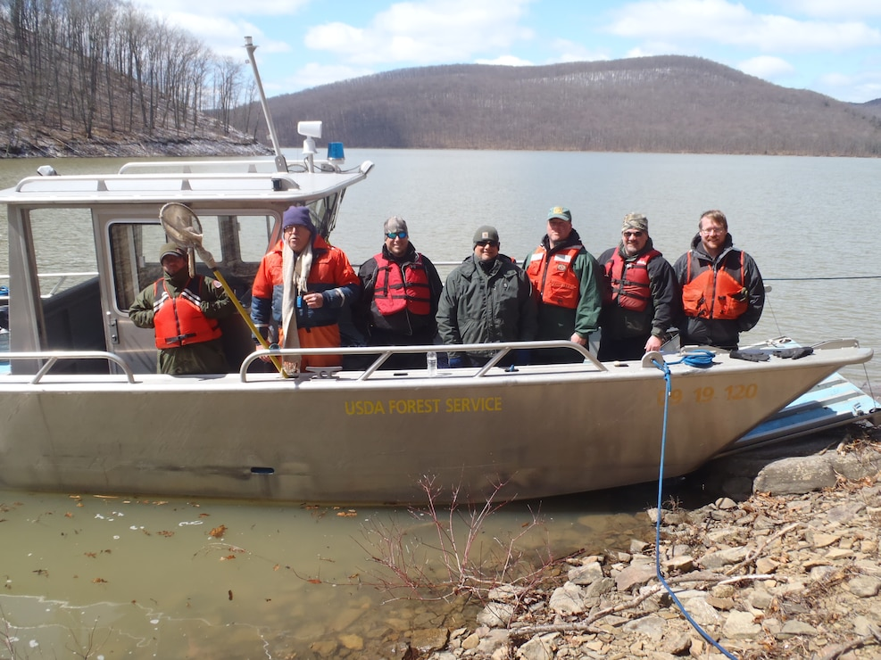 Staff from the USDA Forest Service, PA Fish and Boat Commission, Seneca Nation of Indians, and US Army Corps of Engineers participate in a 2014 interagency fisheries survey at Allegheny Reservoir.
