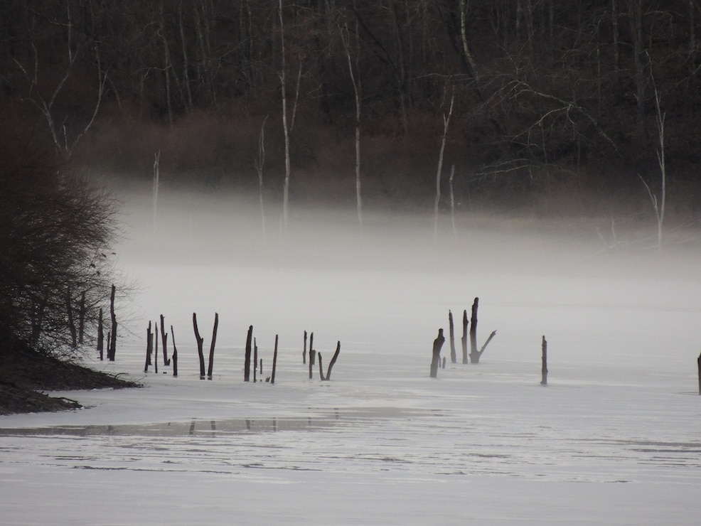 Fog hovers over a partially frozen Stonewall Jackson reservoir. Stonewall Jackson is the only reservoir in the Pittsburgh District that did not have trees removed prior to the filling of its reservoir