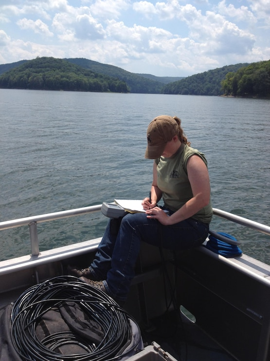 Autumn Rodden (Biologist) takes readings from a water quality sonde in Allegheny Reservoir.