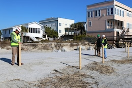 The Charleston District has begun the fencing and grassing project at Folly Beach to build dunes behind the recently completed renourishment project.