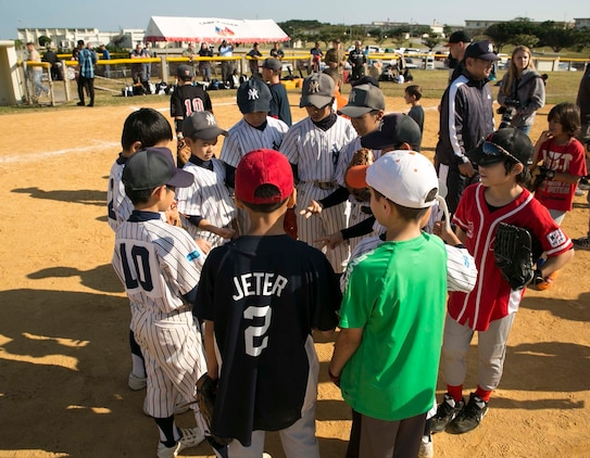 Japanese and American children play rock, paper, scissors before a friendly game of baseball at a baseball clinic Jan. 24 on Camp Kinser. This was the first baseball clinic held on Camp Kinser. Approximately 50 Japanese and American children participated in the event. The clinic consisted of Japanese major league baseball player Keiichi Hirano instructing the players on fundamental skills and techniques of baseball, followed by a friendly game.
