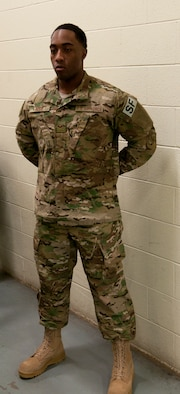 Senior Airman Demetris Ross, 790th Missile Security Forces Squadron Security Support Team, models the new Operation Enduring Freedom Camouflage Pattern uniform Feb. 2, 2015, in the Peacekeeper High Bay on F.E. Warren Air Force Base, Wyo. Defenders across the 20th Air Force who travel out and protect the missile fields will receive the new uniforms as part of the Air Force Global Strike Command Model Defender Program. (U.S. Air Force photo by Airman 1st Class Brandon Valle)