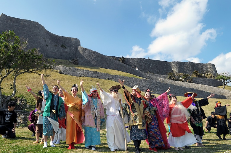 A group of local youth poses for photos in front of the Katsuren Castle ruins on Okinawa, Japan, on Jan. 25, 2015. The group dressed in period costume to perform dances and sing songs in honor of Lord Katsuren, the first lord of the castle in the 13th century. (U.S. Air Force photo by Tim Flack)