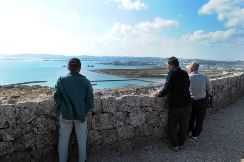 Visitors look out at the view from the top of the Katsuren Castle ruins on Okinawa, Japan, on Jan. 25, 2015.  The castle, which dates back to the 13th century, was added to the World Heritage List in 2000. (U.S. Air Force photo by Tim Flack)