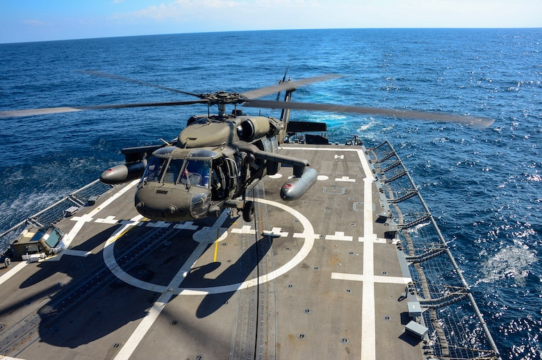 A UH-60 helicopter, assigned to the 1st Battalion, 228th Aviation Regiment makes an approach to the USS Kauffman during deck landing qualifications off the coast of  Honduras, Feb. 1, 2015.  The 1-228th Avn. Reg. aircrew participated in deck landing qualifications on board the USS Kauffman to qualify pilots and crew chiefs on shipboard operations.  Kauffman is on its final scheduled deployment to the U.S. Southern Command area of responsibility supporting multinational, counter-narcotics operation known as Operation Martillo. (U.S. Air Force photo/Tech. Sgt. Heather Redman)