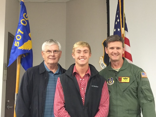All three generations of Humphreys pose for a picture at the enlistment ceremony for Kennedy Humphrey (middle) with his father Lt. Col. Ken Humphrey (right) and grandfather retired Senior Master Sgt. Stephen Humphrey.  All three generations have served in the 507th Air Refueling Wing throughout the years.  (Courtesy photo)