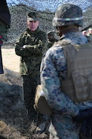 Commandant of the Marine Corps Gen. Joseph F. Dunford, Jr., speaks to Sgt. Brandon L. Rodriguez, section chief with Battery A, Ground Combat Element Integrated Task Force, about the future of the Corps in between fire missions during their final field exercise at Range GP 13 aboard Marine Corps Base Camp Lejeune, North Carolina, Feb. 3, 2015. Dunford visited GCEITF Marines to observe their training and discuss topics pertaining to the Corps, and how the Marines are helping shape a better Marine Corps. From October 2014 to July 2015, the GCEITF will conduct individual and collective level skills training in designated ground combat arms occupational specialties in order to facilitate the standards based assessment of the physical performance of Marines in a simulated operating environment performing specific ground combat arms tasks. (U.S. Marine Corps photo by Sgt. Alicia R. Leaders/Released)