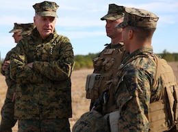 Commandant of the Marine Corps Gen. Joseph F. Dunford, Jr., left, speaks with Captains Raymond P. Kaster, center, company commander of Company A, and Mark A. Lenzi, company commander of Weapons Company, during his observation of the companies' final field exercise at Range G6 aboard Marine Corps Base Camp Lejeune, North Carolina, Feb. 3, 2015. Dunford visited GCEITF Marines to observe their training and discuss topics pertaining to the Corps, and how the Marines are helping shape a better Marine Corps. From October 2014 to July 2015, the GCEITF will conduct individual and collective level skills training in designated ground combat arms occupational specialties in order to facilitate the standards based assessment of the physical performance of Marines in a simulated operating environment performing specific ground combat arms tasks. (U.S. Marine Corps photo by Sgt. Alicia R. Leaders/Released)