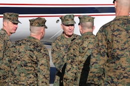 Leadership from Marine Corps Air Station New River and II Marine Expeditionary Force welcome Commandant of the Marine Corps Gen. Joseph F. Dunford Jr., after landing at the air station, Feb. 3, 2015. Dunford flew to North Carolina to visit Ground Combat Element Integrated Task Force Marines to observe their training and discuss the future of the Corps, and how the Marines are helping shape a better Marine Corps. From October 2014 to July 2015, the GCEITF will conduct individual and collective level skills training in designated ground combat arms occupational specialties in order to facilitate the standards based assessment of the physical performance of Marines in a simulated operating environment performing specific ground combat arms tasks. (U.S. Marine Corps photo by Sgt. Alicia R. Leaders/Released)