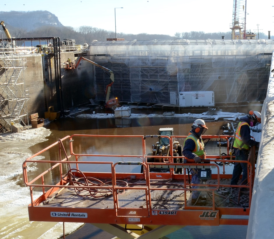 Kris Taverna, left, and Dale Rud, both of operations, work to remove damaged concrete from the lockwall at Lock and Dam 5A on January 15, 2015. Lock 5A was closed to navigation on Dec. 1, 2014, in order to complete the necessary work by March 9, 2015.