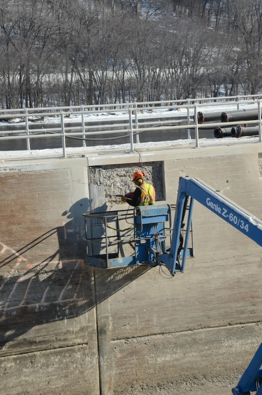 Jordon Johnson, operations, operates a jackhammer to remove damaged concrete on Lock and Dam 5A's lock chamber walls on January 15, 2015. Lock 5A was closed to navigation on Dec. 1, 2014, in order to complete the necessary work by March 9, 2015.