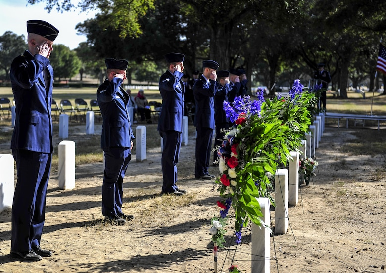 Airmen salute the graves of Spirit 03 crew members during a remembrance ceremony at Barrancas National Cemetery on Naval Air Station Pensacola, Fla., Jan. 31, 2015. During the Battle of Khafji, Spirit 03, an AC-130H Spectre, was shot down in the early hours of Jan. 31, 1991. (U.S. Air Force photo/Airman 1st Class Jeff Parkinson)