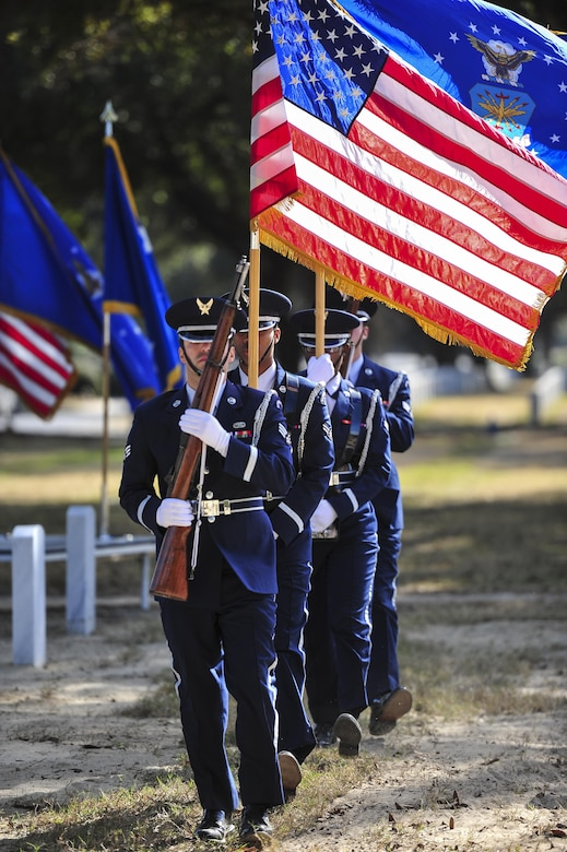 Hurlburt Field Honor Guard members post the colors during a remembrance ceremony at Barrancas National Cemetery on Naval Air Station Pensacola, Fla., Jan. 31, 2015. The ceremony honored the crew of AC-130H Spectre, Spirit 03, which was shot down Jan. 31, 1991, during the Battle of Khafji. (U.S. Air Force photo/Airman 1st Class Jeff Parkinson)