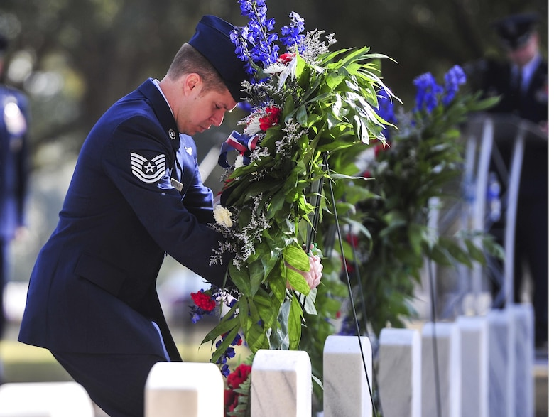 Tech. Sgt. Raymond Kessner, 18th Flight Test Squadron AC-130J sensor operator, lays a wreath during a remembrance ceremony at Barrancas National Cemetery on Naval Air Station Pensacola, Fla., Jan. 31, 2015. The ceremony honored the crew of AC-130H Spectre, Spirit 03, which was shot down Jan. 31, 1991, during the Battle of Khafji. (U.S. Air Force photo/Airman 1st Class Jeff Parkinson)