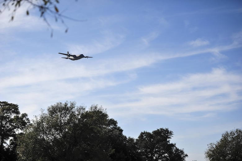 A soon-to-be retired AC-130H Spectre makes a final flyover during a remembrance ceremony at Barrancas National Cemetery on Naval Air Station Pensacola, Fla., Jan. 31, 2015. The AC-130H Spectre's primary missions are close air support, air interdiction and armed reconnaissance. (U.S. Air Force photo/Airman 1st Class Jeff Parkinson)
