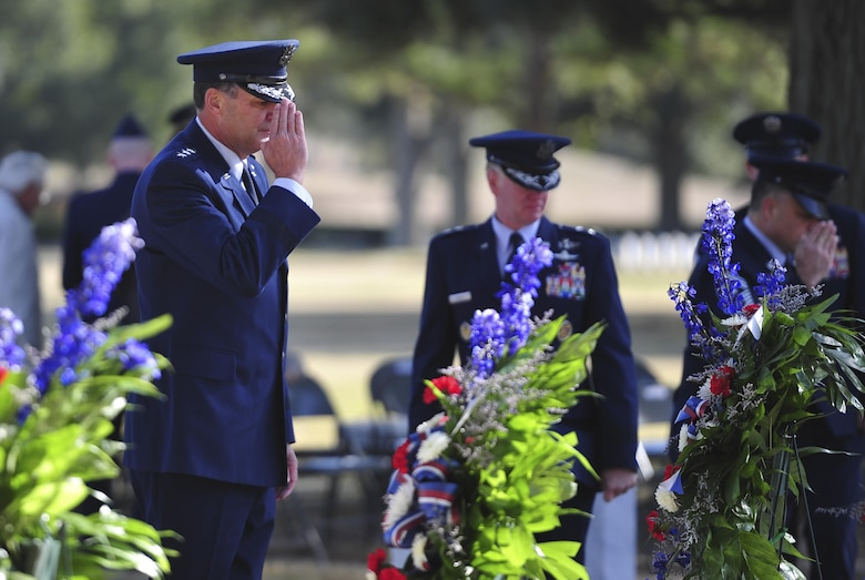 Lt. Gen. Brad Heithold, Air Force Special Operations Command commander, salutes the graves of Spirit 03 crew members during a remembrance ceremony at Barrancas National Cemetery on Naval Air Station Pensacola, Fla., Jan. 31, 2015. Losing Spirit 03 and its crew members was the largest single loss by an Air Force unit during Operation Desert Storm. (U.S. Air Force photo/Airman 1st Class Jeff Parkinson)