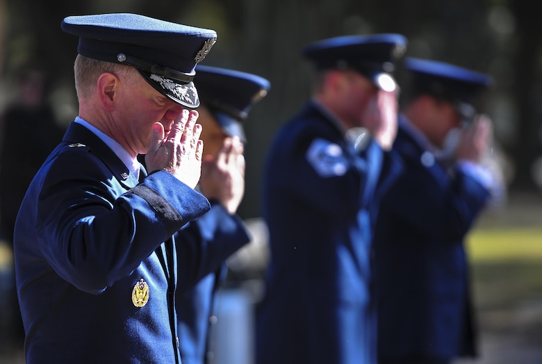 Maj. Gen. Mark Hicks, Air Force Special Operations Command director of operations, salutes the graves of Spirit 03 crew members during a remembrance ceremony at Barrancas National Cemetery on Naval Air Station Pensacola, Fla., Jan. 31, 2015. Losing Spirit 03 and its crew members was the largest single loss by an Air Force unit during Operation Desert Storm. (U.S. Air Force photo/Airman 1st Class Jeff Parkinson)
