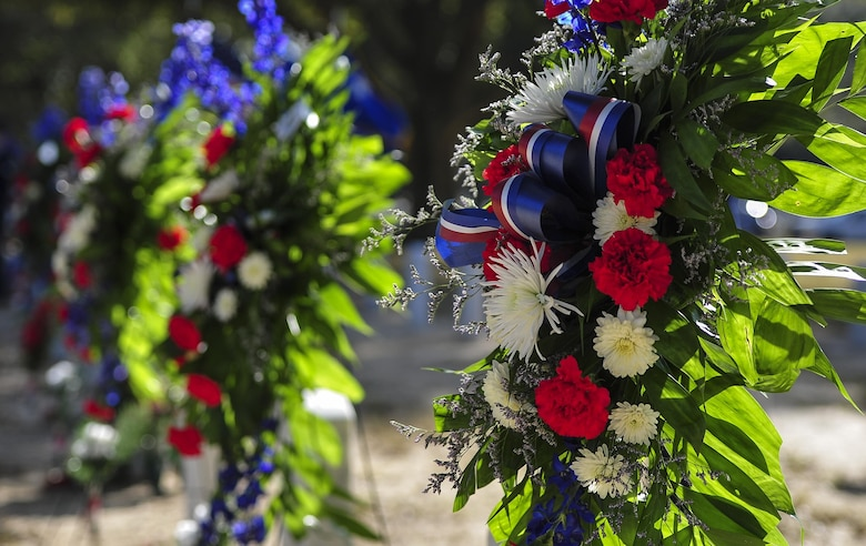 Wreaths are displayed on the graves of Spirit 03 crew members during a remembrance ceremony at Barrancas National Cemetery on Naval Air Station Pensacola, Fla., Jan. 31, 2015. While providing support for joint forces on Jan. 31, 1991, Spirit 03 was shot down, and 14 crew members lost their lives. (U.S. Air Force photo/Airman 1st Class Jeff Parkinson)