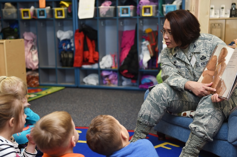 Col. Rose Jourdan, 460th Mission Support Group commander, reads to children at the Crested Butte Child Development Center Feb. 3, 2015, on Buckley Air Force Base, Colo. Jourdan read to the children in honor of Black History Month. (U.S. Air Force photo by Airman 1st Class Samantha Saulsbury/Released)