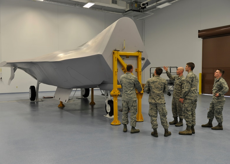 Technical Sgt. James Harper, 372nd Training Support Squadron Detachment 4 F-22 Raptor fuels system instructor, shows students the fuels system trainer Feb. 2 at the 372nd TSS building. Harper trains the students so they can better understand the F-22 fuel system. (U.S. Air Force photo by Airman 1st Class Sergio A. Gamboa/Released)