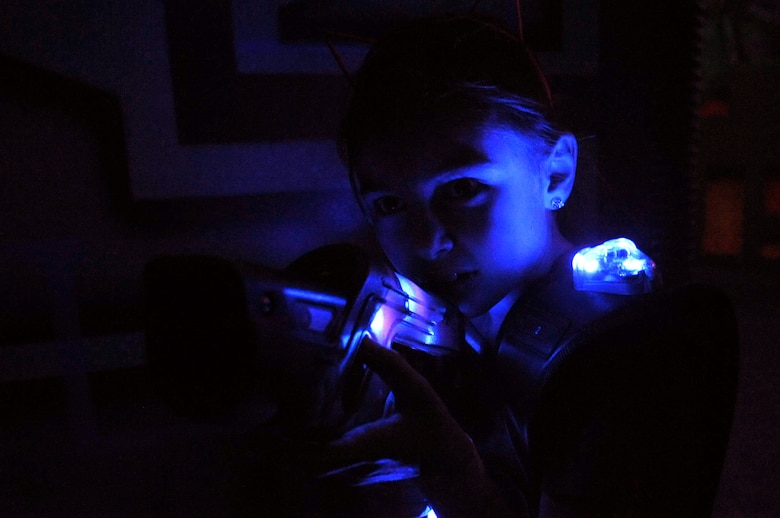 Joei Hager, 8, plays laser tag with other children from Grand Forks Air Force Base, N.D.,  at Northern Air Family Fun Center in Grand Forks, Feb. 2, 2015. Service members and children from the base were invited to take part in a military appreciation night event that also featured a trampoline park and free pizza and ice cream. (U.S. Air Force photo/Staff Sgt. Susan L. Davis)