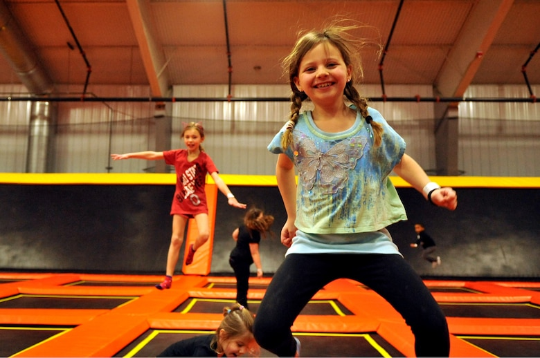 Leah Davis, 7, and more children from Grand Forks Air Force Base, N.D., jump on trampolines at Northern Air Family Fun Center in Grand Forks, Feb. 2, 2015. Service members and children from the base were invited to take part in a military appreciation night event featuring a trampoline park, laser tag, and free pizza and ice cream. (U.S. Air Force photo/Staff Sgt. Susan L. Davis)
