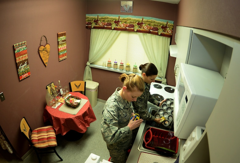 Airman 1st Class Lauren O?Connor, foreground, and Senior Airman Shellby Matullo, 2nd Bomb Wing Public Affairs broadcast journalists, wash dishes together in their shared kitchen on Barksdale Air Force Base, La., Feb. 2, 2015. One of the keys to success in sharing a living space is having open lines of communication which these Airmen maintain on a constant basis. (U.S. Air Force photo/Airman 1st Class Curt Beach)