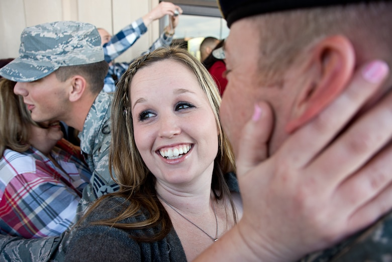 Family and friends greet members of the 137th Security Forces Squadron, OK on Feb. 3rd, 2015 at Will Rogers World Airport, Oklahoma City after returning home from a six-month deployment to Southwest Asia.