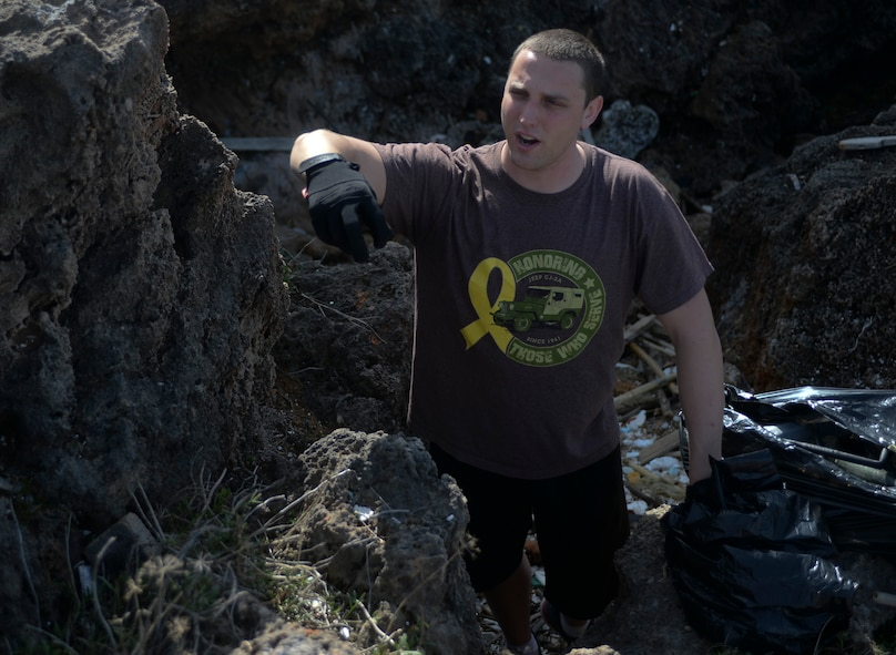 U.S. Air Force Senior Airman Tyler Marcee, a 52nd Expeditionary Logistics Readiness Squadron fuels journeyman, directs fellow Airmen during a beach cleanup at Chania, Greece, Jan. 31, 2015. Marcee organized the beach cleanup after seeing the trash along the shoreline during a previous trip there. (U.S. Air Force photo by Staff Sgt. Joe W. McFadden/Released)