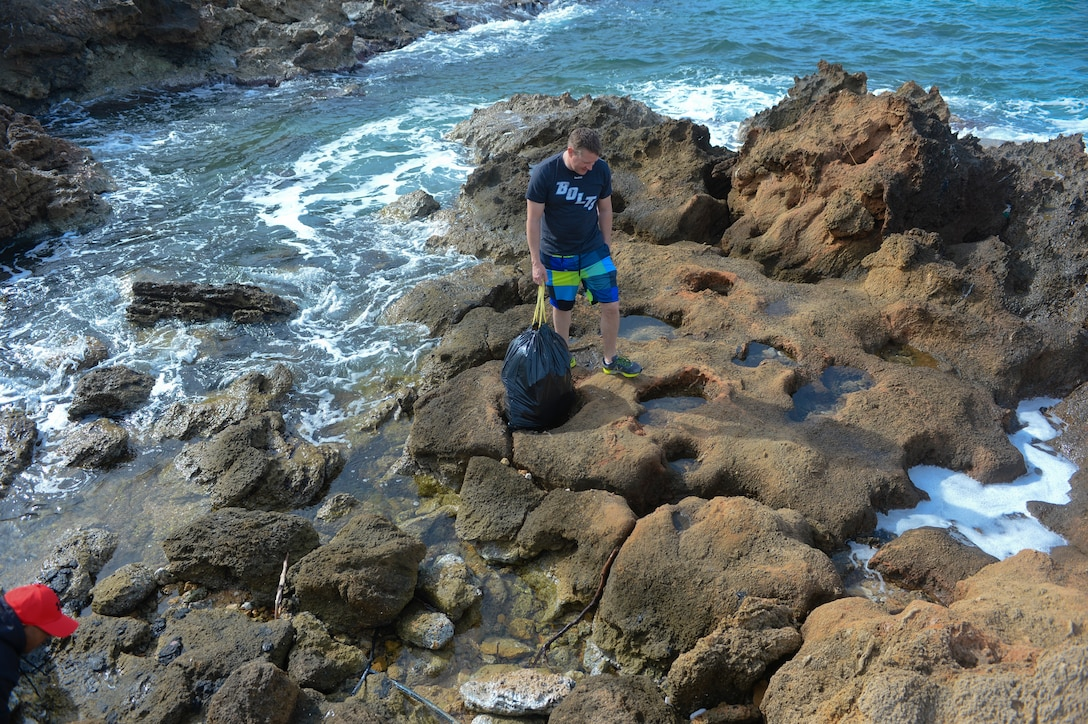 U.S. Air Force Master Sgt. Andrew Hogan, fuels manager assigned to the 52nd Expeditionary Logistics Readiness Squadron, looks for trash during a beach cleanup at Chania, Greece, Jan. 31, 2015. The Airmen participated in the cleanup during the downtime from a flying training deployment between the U.S. and Hellenic air forces at Souda Bay, Greece. (U.S. Air Force photo by Staff Sgt. Joe W. McFadden/Released)