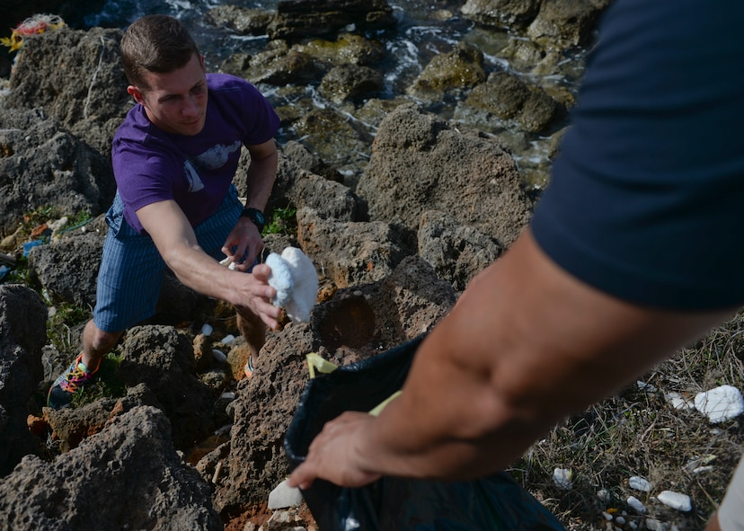 U.S. Air Force Senior Airman Sean Melcher, a 52nd Expeditionary Logistics Readiness Squadron fuels journeyman collect trash during a beach cleanup at Chania, Greece, Jan. 31, 2015. The Airmen participated in the cleanup during the downtime from a flying training deployment between the U.S. and Hellenic air forces at Souda Bay, Greece. (U.S. Air Force photo by Staff Sgt. Joe W. McFadden/Released)