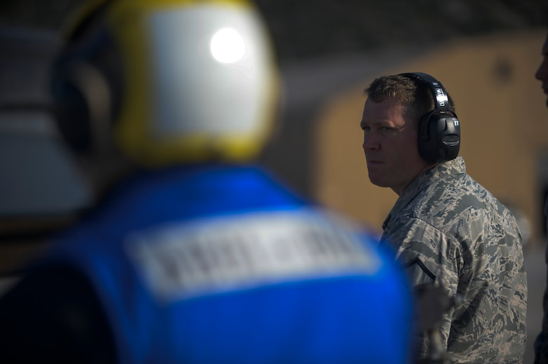 U.S. Air Force Master Sgt. Andrew Hogan, fuels manager assigned to the 52nd Expeditionary Logistics Readiness Squadron, observes an F-16 Fighting Falcon fighter aircraft being refueled on the flightline during a flying training deployment at Souda Bay, Greece, Jan. 30, 2015.  The hot pit refueling process involved pumping engine fuel into an aircraft as its engine still runs, enabling it to continue flying operations with minimum interruption. (U.S. Air Force photo by Staff Sgt. Joe W. McFadden/Released)