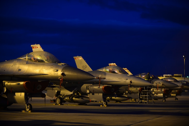 A row of U.S. Air Force F-16 Fighting Falcon fighter aircraft assigned to the 480th Expeditionary Fighter Squadron remain parked on the flightline during a flying training deployment at Souda Bay, Greece, Jan. 30, 2015. The aircraft conducted the training as part of the bilateral deployment between the Greek and U.S. Air Forces to develop interoperability and cohesion between the two NATO partners. (U.S. Air Force photo by Staff Sgt. Joe W. McFadden/Released)