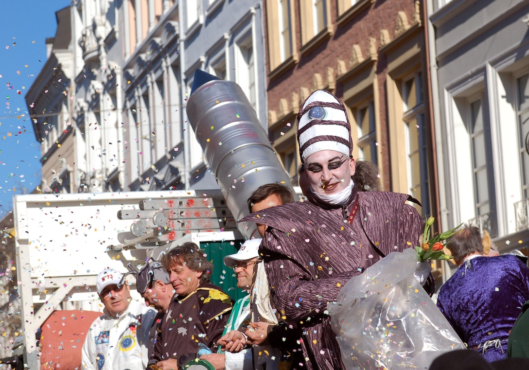 The Harlequin spreads confetti over the crowd during a past Fasching parade in Trier, Germany. Many local communities will host Fasching parades up until Ash Wednesday, Feb. 18.  Many of the parades will take place Feb. 14-16. Observers stand in the streets, cheering, singing and dancing. For any parade, people and children are advised to bring bags to collect the candies and sweets that the Fasching fools hand out or throw into the crowd. Although it is not a must, some people dress up for viewing a parade. Music and entertainment typically occurs in public spots following the parades. (U.S. Air Force photo by Iris Reiff/Released)