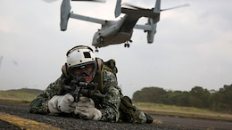 A Philippine Marine posts security after fast-roping out of an MV-22B Osprey tiltrotor aircraft Jan. 22 at Basa Air Field. Fast-roping is just one of the multiple training events conducted during Aviation Assault Support Exercise 15.1. AASE expands and promotes cooperative training opportunities with the Armed Forces of the Philippines to enhance core skill proficiency and to increase operational readiness. The Philippine Marines are with various units and the U.S. Marines are with 3rd Battalion, 3rd Marine Regiment currently assigned to 3rd Marine Division, III Marine Expeditionary Force under the unit deployment program. (U.S. Marine Corps photo by Lance Cpl. Ryan C. Mains/Released).
