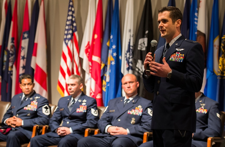 Air Force advisor Capt. Jeremy Powell, an honoree from the Air Force's ninth volume of Portraits in Courage, tells his story to a group of Air Force civic leaders from around the country, during a luncheon Feb. 4, 2015, Arlington, Va. Portraits in courage is an Air Force program highlighting Airmen for their honor, valor, devotion and selfless sacrifice in the face of extreme danger to themselves and others. (U.S. Air Force photo/Jim Varhegyi)